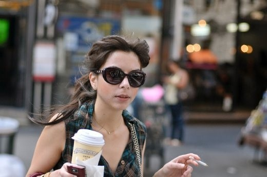 Woman with cup of coffee in hand